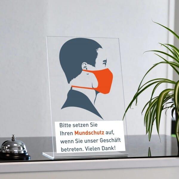 """Acrylaufsteller """"Bitte setzen Sie Ihren Mundschutz auf."""" Orange (ca. 200x300 mm)"""
