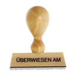 Holzstempel ÜBERWIESEN AM (50x10 mm - 1 Zeile)